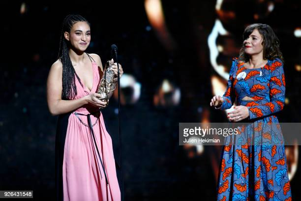 Camelia Jordana poses with the best newcomer female actor Award for the movie Le Brio given by Blanche Gardin during the Cesar Film Awards 2018 at...