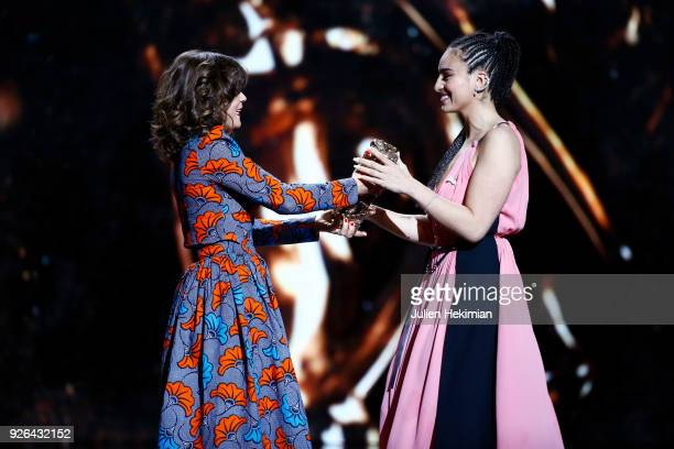 Camelia Jordana receives rom by Blanche Gardin the best newcomer female actor Award for the movie Le Brio f during the Cesar Film Awards 2018 at...