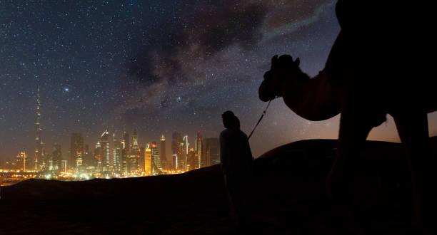 Camels caravan arriving in a futuristic city