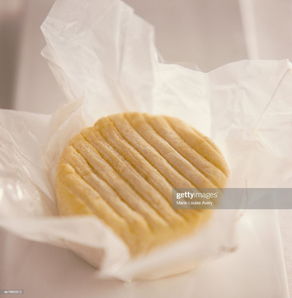 Camembert Cheese in Paper : Stock Photo