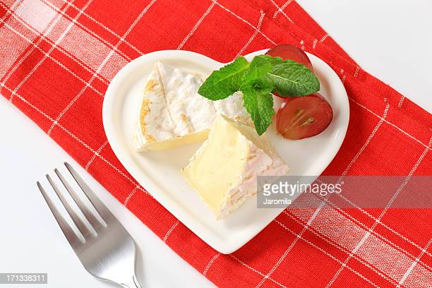 camembert cheese on a heart-shaped plate