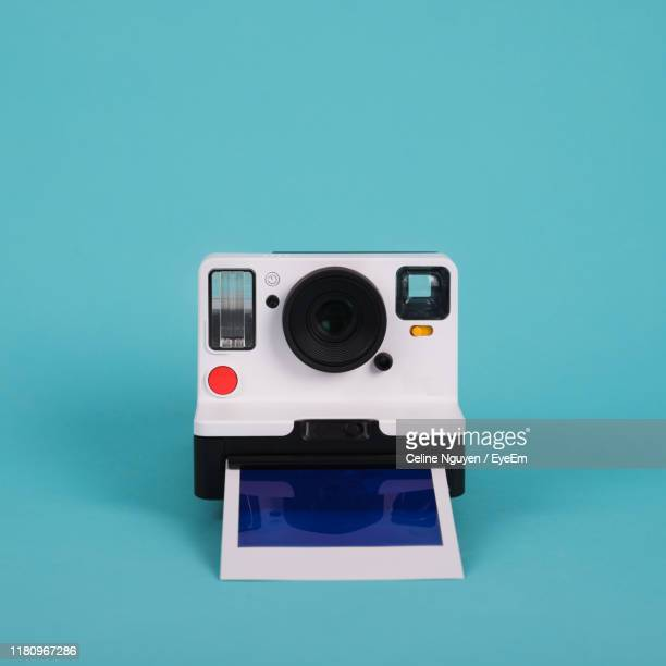 camera against blue background - still life stock pictures, royalty-free photos & images