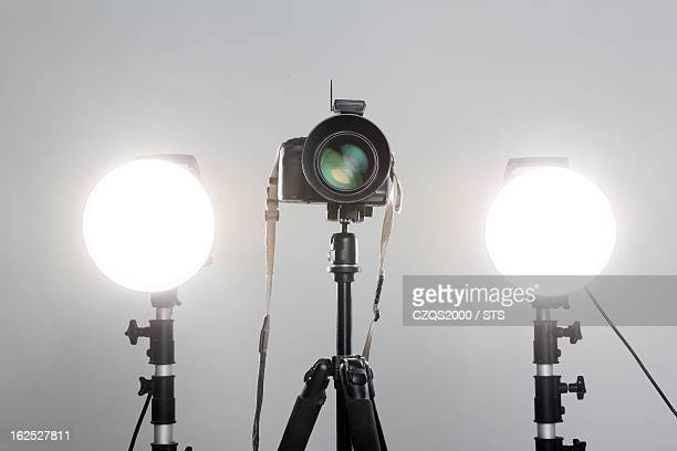 camera and flash lights in studio