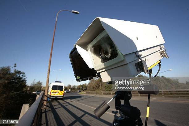 Camera and infra-red vehicle number plate recognition camera operated by Greater Manchester Police looks down on vehicles travelling on the M62...