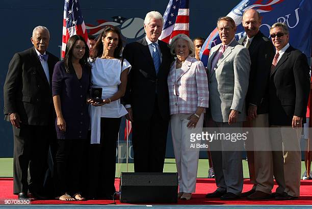 Camera Ashe Jeanne Marie Moutoussamy former President Bill Clinton and USTA president Lucy S Garvin at the ceremony to induct Ashe into the US Open...