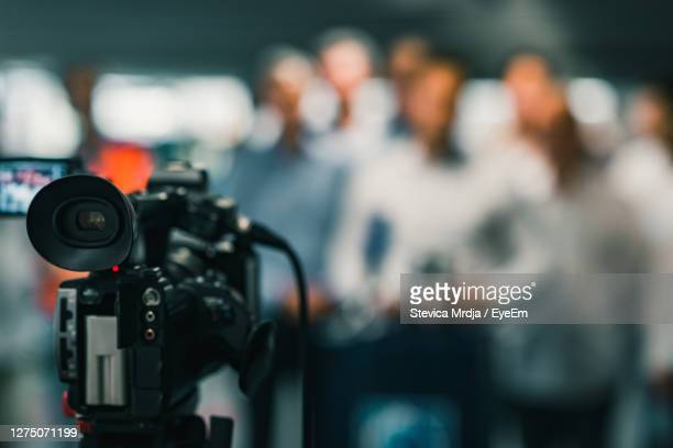 camera at media conference - press conference stock pictures, royalty-free photos & images