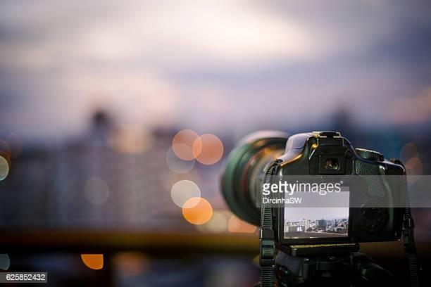 Camera at tripod photographing   urban Landscape.
