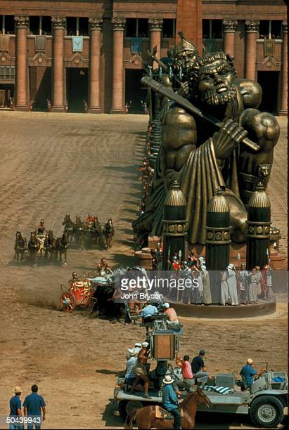 Camera being pulled on flatbed truck filming famous chariot race fr motion picture Ben Hur