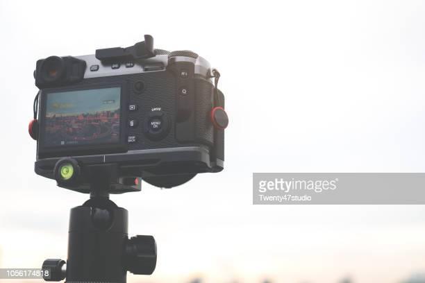 camera capturing time-lapse on tripod - 三脚 ストックフォトと画像