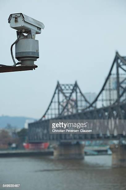 camera chinese - north korea border bridge - yalu river stock pictures, royalty-free photos & images