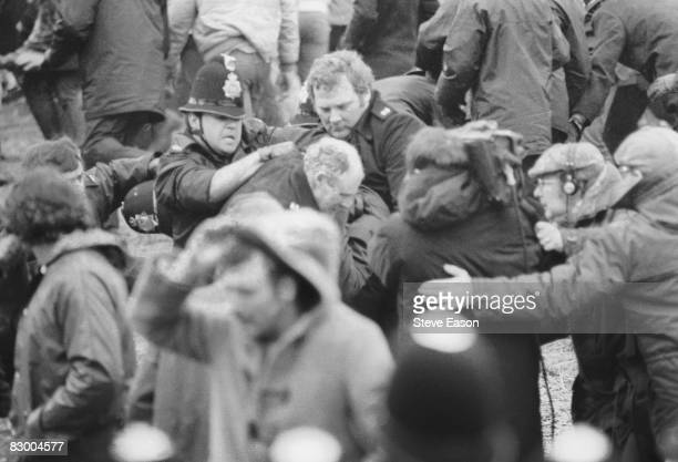 A camera crew fims a scuffle between police and miners at a demonstration at Orgreave Colliery South Yorkshire during the miners' strike 2nd June 1984
