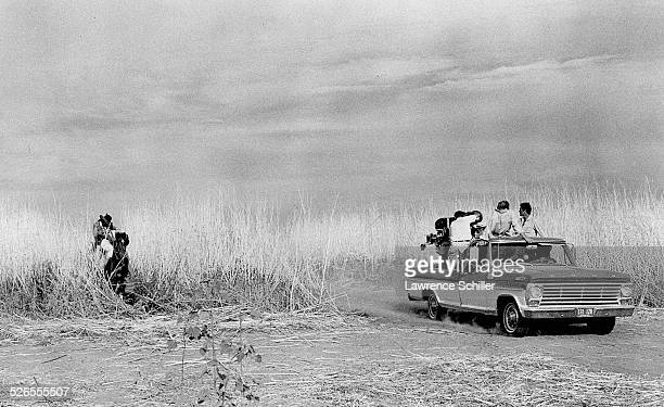 A camera crew in a pickup truck films an horse riding sequence in the film 'Blue' Moab Utah 1967