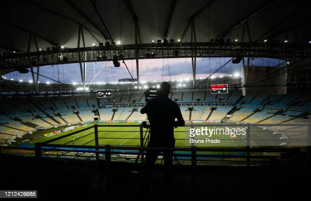 Camera crew member works in an empty stadium during a match between Flamengo and Potuguesa as part of the Rio State Championship 2020, to be played...