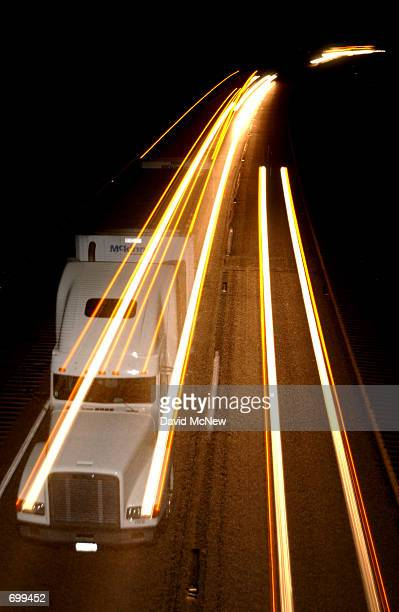 A camera effect captures a truck speeding through the night February 6 2002 along Interstate 15 west of Las Vegas NV Interstate 15 is a primary...