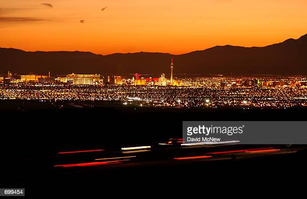 A camera effect captures blurred trucks speeding along Interstate 15 February 7 2002 north of Las Vegas NV along the primary proposed route for...