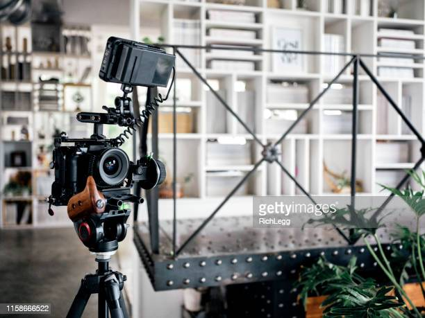 camera equipment in a shared office workspace interior - film set stock pictures, royalty-free photos & images