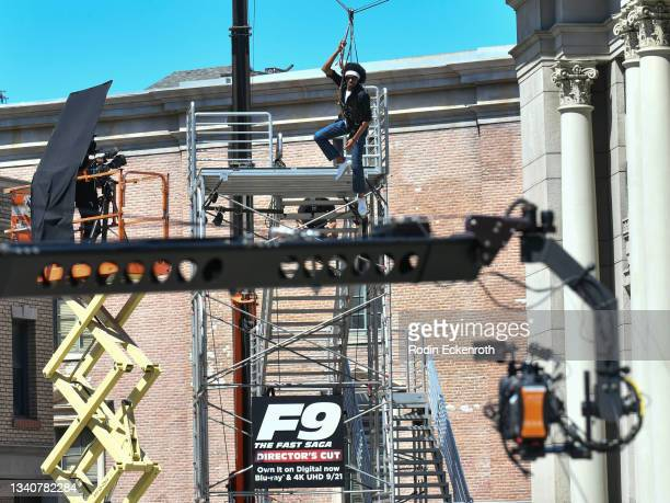 Camera films an attendee ziplining at the F9 Fest event on the Universal Studios backlot celebrating F9: The Fast Saga on September 15, 2021 in...
