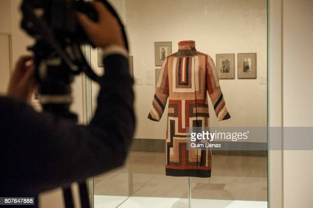 A camera films the 'Abrigo para Gloria Swanson' during the press preview of the exhibition 'Sonia Delaunay Art Design and Fashion' at...