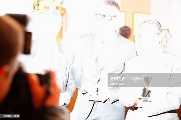 Camera flash while holding awards