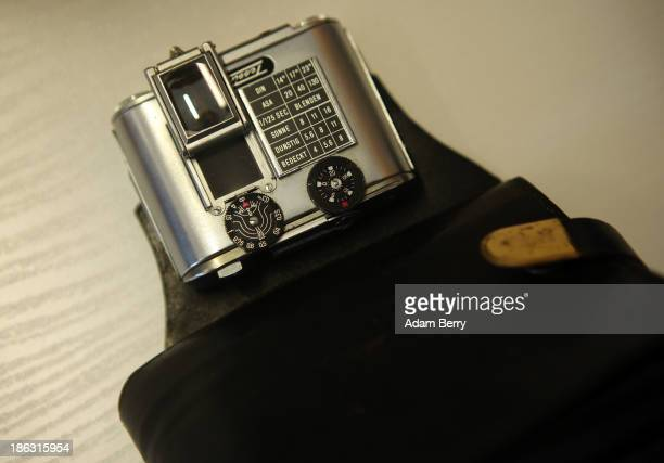 A camera hidden inside of a wallet is displayed at the Stasi or East German Secret Police Museum on October 30 2013 in Berlin Germany German...