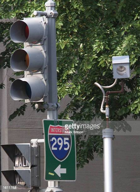 A camera is placed near a traffic light for drivers who run red lights on Constitution Avenue August 31 2001 in Washington DC The camera will take a...