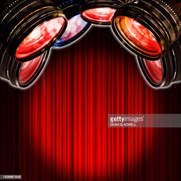 camera lenses red curtains - premiere stock pictures, royalty-free photos & images