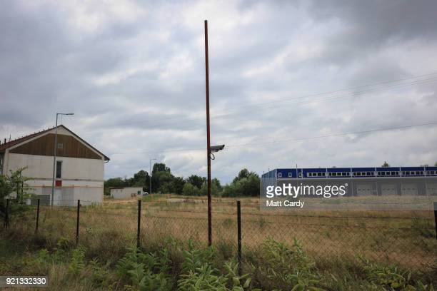 CCTV camera looks over the old migrant reception centre on July 16 2016 in Roszke Hungary Last summer thousands of refugees and migrants were using...