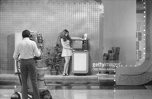 A camera man films as model Janice Pennington displays a television set in an episode of the CBS game show 'The New Price is Right' Studio 33...