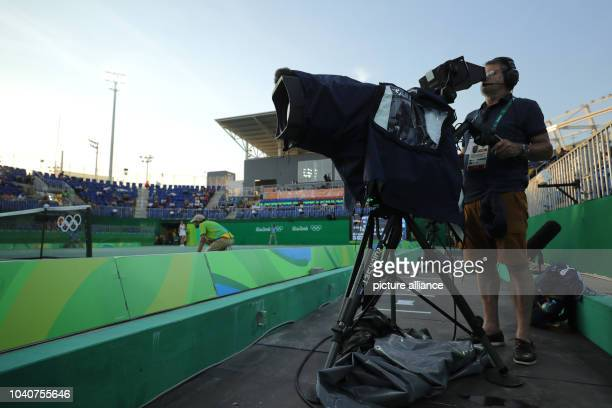 TV camera man films the match Petkovic of Germany against Svitolina of Ukraine during the Tennis Women's Singles First Round of the Rio 2016 Olympic...