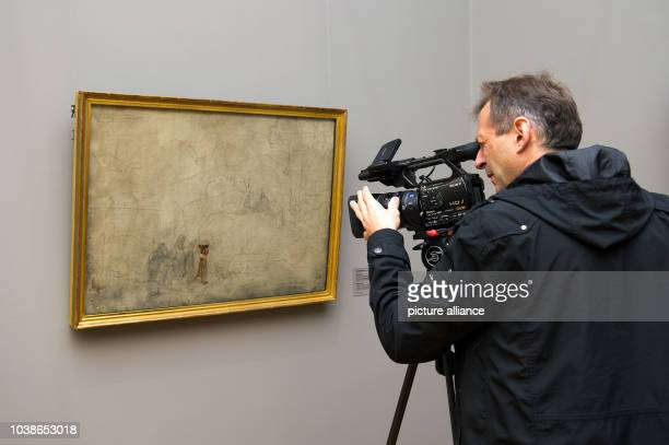 Camera man films the painting 'Feierabend' by Ludwig Richter from 1824 at Albertinum at New Masters Gallery in Dresden, Germany, 27 September 2013....