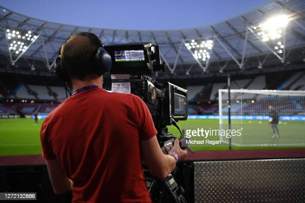 Camera man films the warm up prior to the Premier League match between West Ham United and Newcastle United at London Stadium on September 12, 2020...