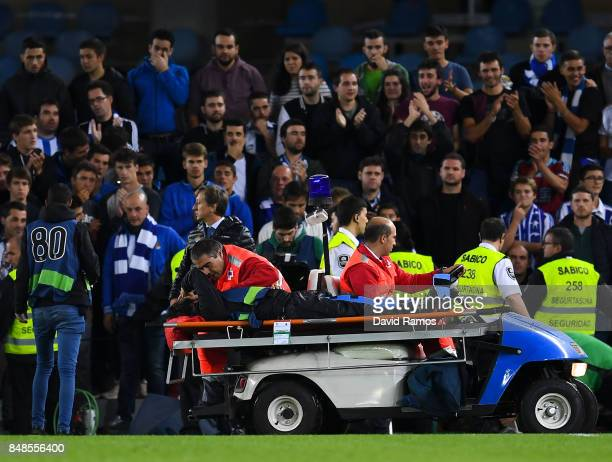 A camera man is evacuate on stretcher after being injured when the advertising board collapsed as Real Sociedad supporters celebrated Kevin Rodrigues...