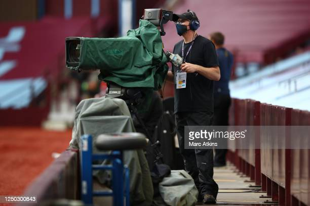 Camera man is seen filming whilst wearing a face mask during the Premier League match between Aston Villa and Sheffield United at Villa Park on June...