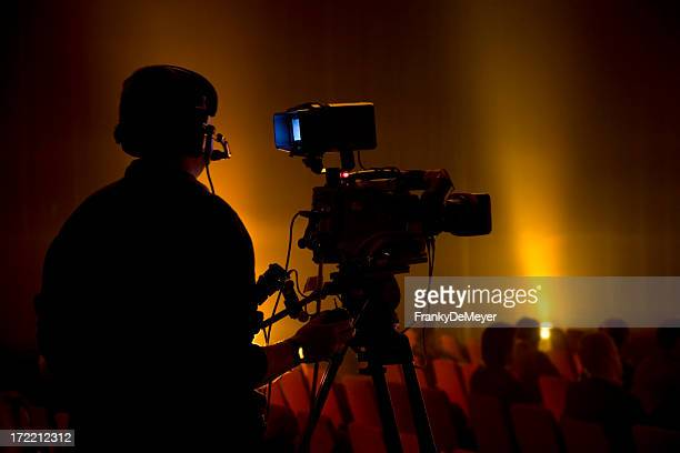 camera man silhouette with audience - spotlight film stock photos and pictures