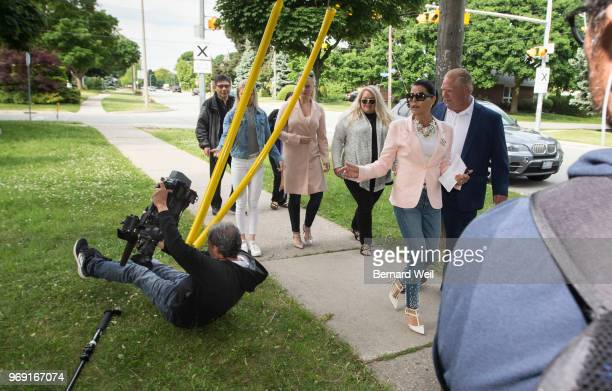 TORONTO ON JUNE 7 A camera man trips as Ontario PC Leader Doug Ford walks with his wife Karla and family to St George's Junior School Polling Station...