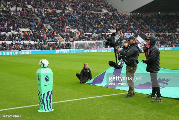 A camera man waits for the teams to walk out prior to the Premier League match between Newcastle United and Chelsea FC at St James Park on August 26...