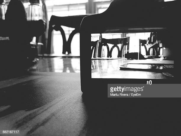camera on table in restaurant - digital viewfinder stock pictures, royalty-free photos & images