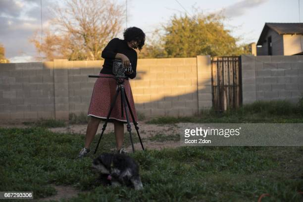 Camera operator and director in backyard