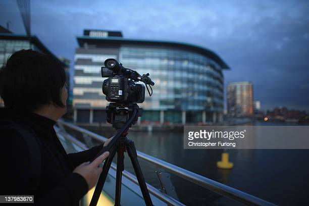 A camera operator films outside the BBC studios at Media City on January 30 2012 in Salford England The BBC is soon to be joined by new neighbour ITV...