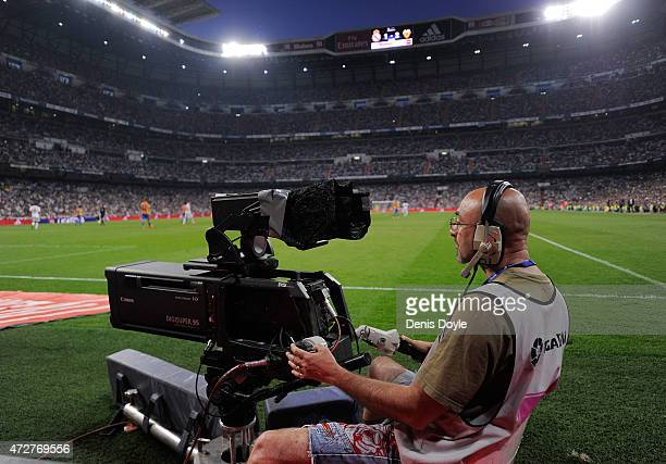 A camera operator films the La Liga match between Real Madrid CF and Valencia CF at the estadio Santiago Bernabeu on May 9 2015 in Madrid Spain The...