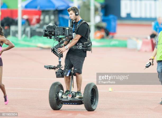 Camera operator with Steadicam Camera Stabilizing Systems