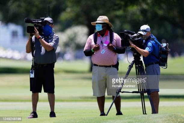 TV camera operators wear masks due to COVID19 precautions during the second round of the Charles Schwab Challenge on June 12 2020 at Colonial Country...