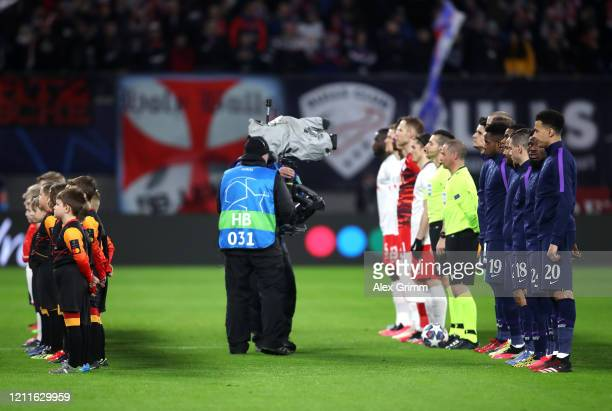 Camera person in action as both teams line up during the UEFA Champions League round of 16 second leg match between RB Leipzig and Tottenham Hotspur...