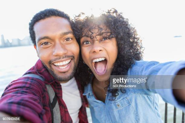 Camera point of view of young couple taking selfie