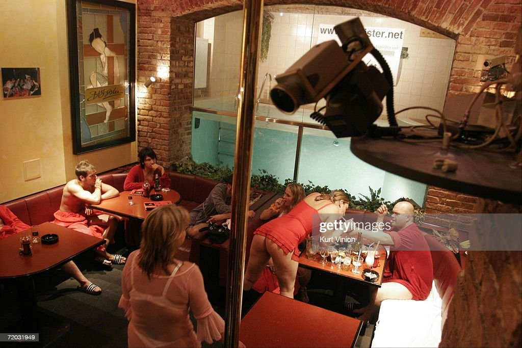 A camera records the action in the club room at Big Sister