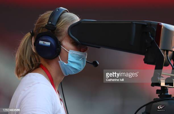 Camera women wearing a protective mask while working to the Premier League match between Southampton FC and Arsenal FC at St Mary's Stadium on June...