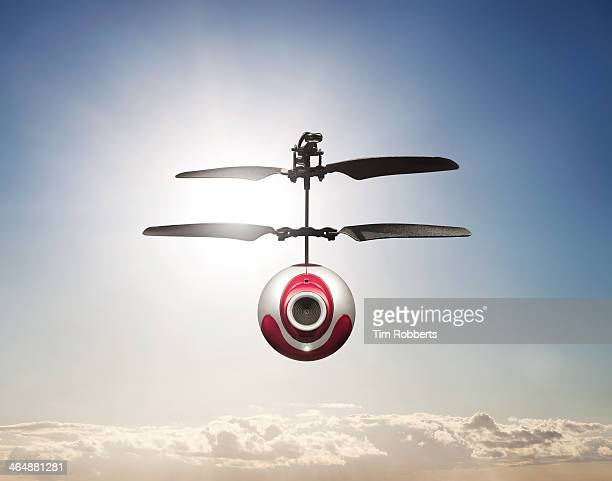Camera-Drone hovering in sky.