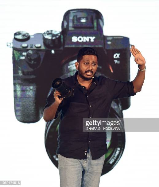 CameraLK managing director Anushka Gunasinghe presents the new Sony alpha A7 lll camera during the launch ceremony in Colombo on April 26 2018