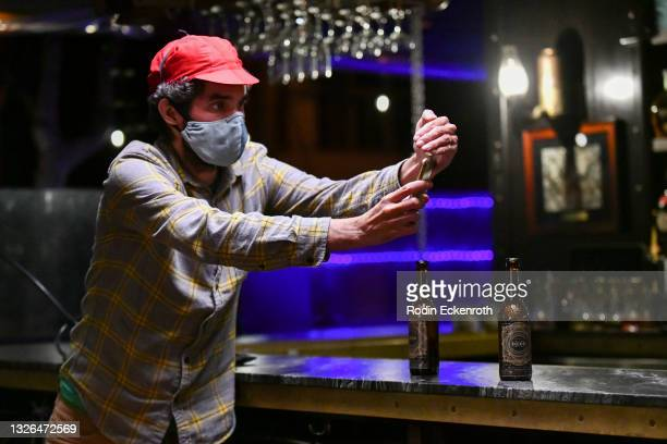 """Cameraman Aaron Wise meters light during production of the indie feature film, """"The Star City Murders"""" on July 01, 2021 in Los Angeles, California...."""