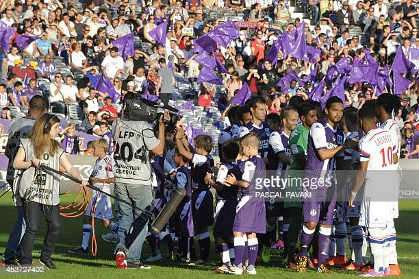 A cameraman and a boom operator work during the French L1 football match between Toulouse and Lyon on August 16 2014 at the Municipal Stadium in...